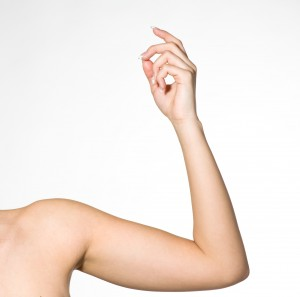 Raised arm showing forearm.